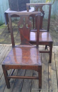Some views of two of the set of six oak chairs